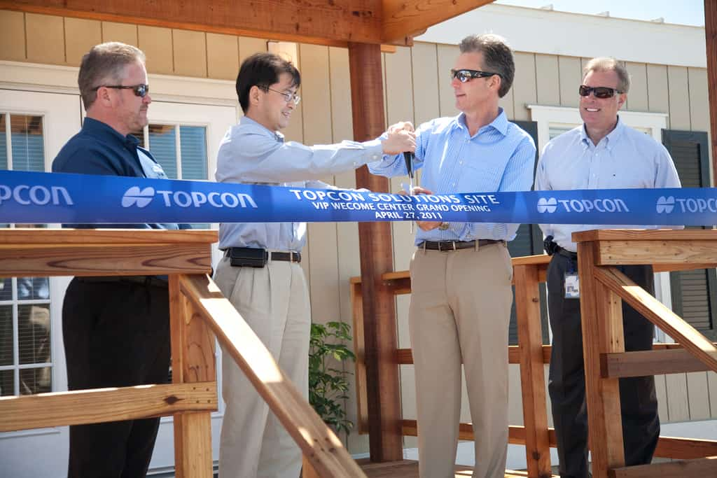 Topcon ribbon cutting with Mark Contino, Mick Yamazaki, Ray O'Connor, Mark Bittner.