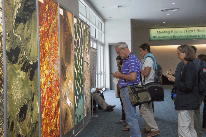 """The """"Where in the World"""" game is an annual favorite among attendees. Individuals take their best guesses to figure out where on the Earth the poster sized aerial imagery represents."""