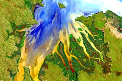 This image is a portion of the first Landsat 8 scene acquired May 12, 2013 (Path 107, Rows 70-71) in Western Australia. Geoscience Australia, a Landsat International Cooperator and a Landsat Science Team Member, produced this enhanced image. Water and land were masked, separately enhanced, and then reassembled.   The water patterns are the result of an RGB display of the Landsat 8 red, blue, and ultra-blue bands (bands 4, 2, 1) and the land is shown using SWIR, NIR, and green (bands 6, 5, 3). The resulting image displays impressive sediment and nutrient patterns in the tropical estuary area, and the complex patterns and conditions in the vegetated areas.