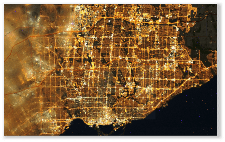 Aerial Image of the GTA, showing light pollution hotspots in white light. Major streets and Highways can clearly be identified.