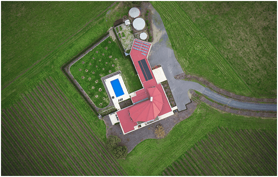 Figure (v) Aerial photograph of a property used for real estate sales, (Swarm AUV)