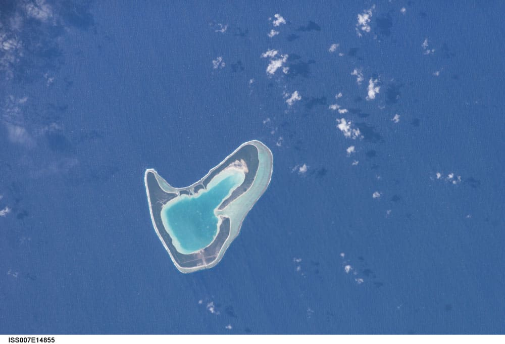 Tupai Atoll photographed from the International Space Station.  Photo: NASA, public domain.