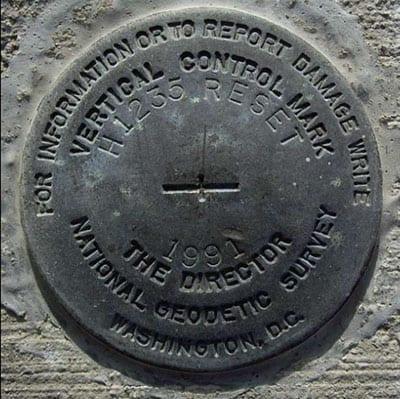 National Geodetic Survey vertical control mark, Santa Rita Bridge, California State Highway 152. Photo: Michelle Sneed, USGS. Public domain.
