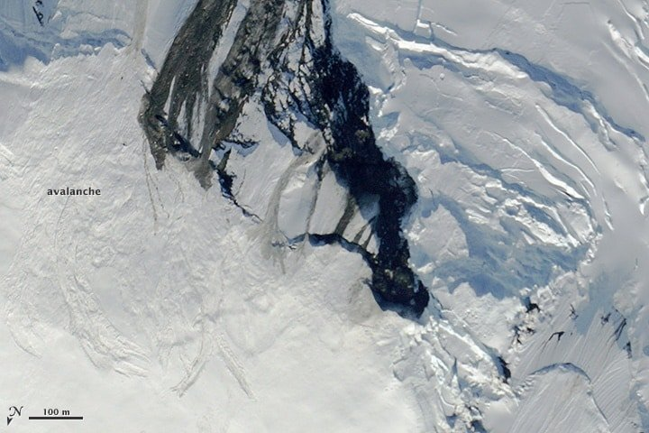 A camera onboard NASA's high-altitude ER-2 aircraft captured this earthquake induced avalanche in northwestern Canada. Source: NASA, public domain