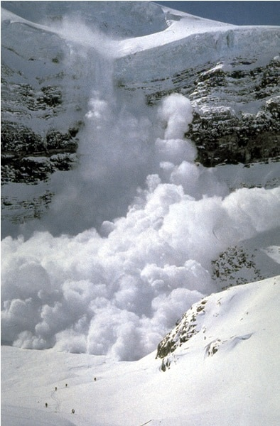 Avalanche in Rocky Mountain National Park.  Note the skiers at the bottom of the photo.  Photo: Rocky Mountain, NPS, public domain.