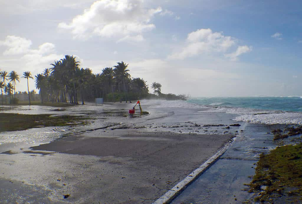 Sea level rise is a threat to low-lying coastal populations.  Photo shows results of wave-driven flooding and overwash on Roi-Namur Atoll, Republic of the Marshall Islands. Photo: Peter Swarzenski, USGS. Public domain.