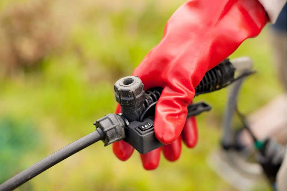 The 3-way switch on a backpack sprayer handle. Photo: Harley Schinagl