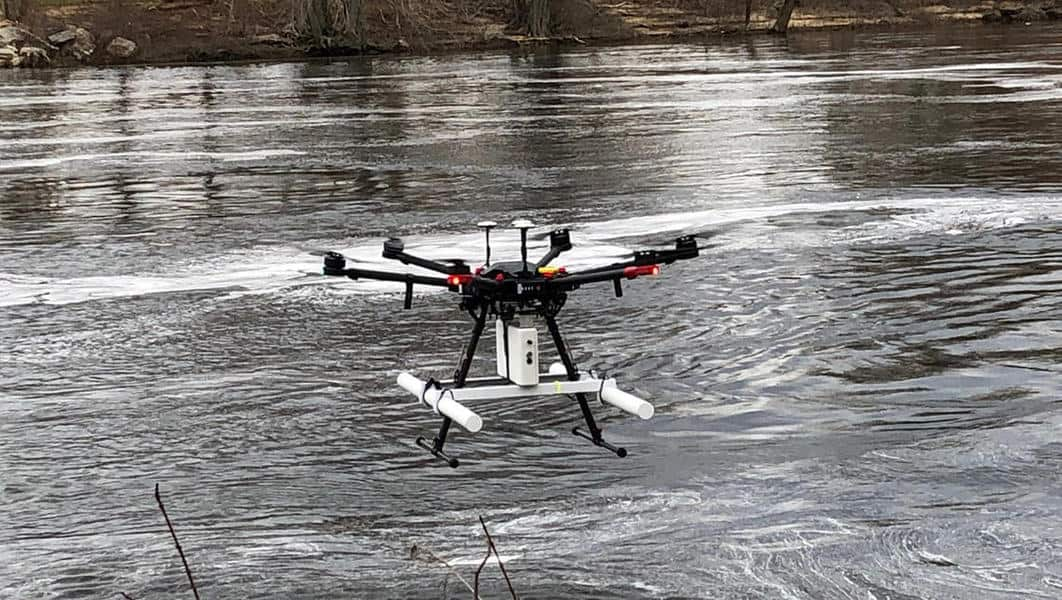 Drone with ground-penetrating radar system flying close over river surface. Photo: John W. Lane, USGS. Public domain.