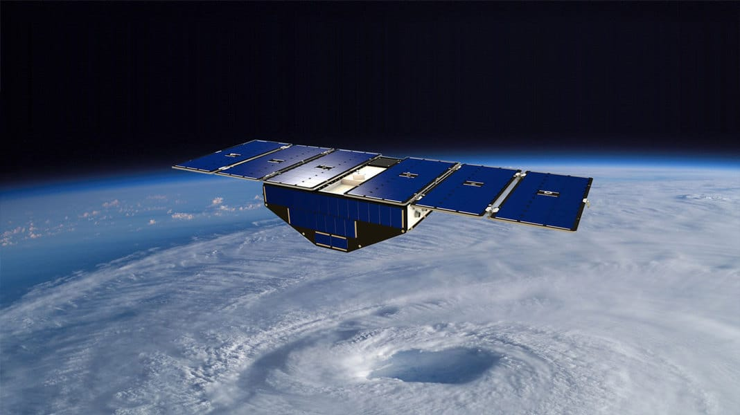 Illustration of one of the eight CYGNSS satellites in orbit above a hurricane.
